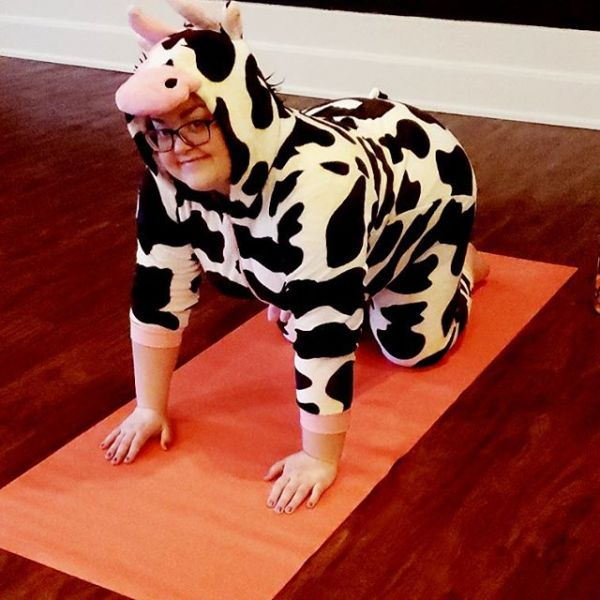 It might be Halloween....or we might just really love cow pose. Or both.